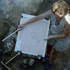 Arkeolog på en utgrävning.